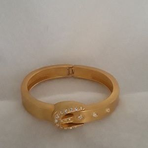 Jewelry - Gold toned hinged buckle bracelet with rhinestones